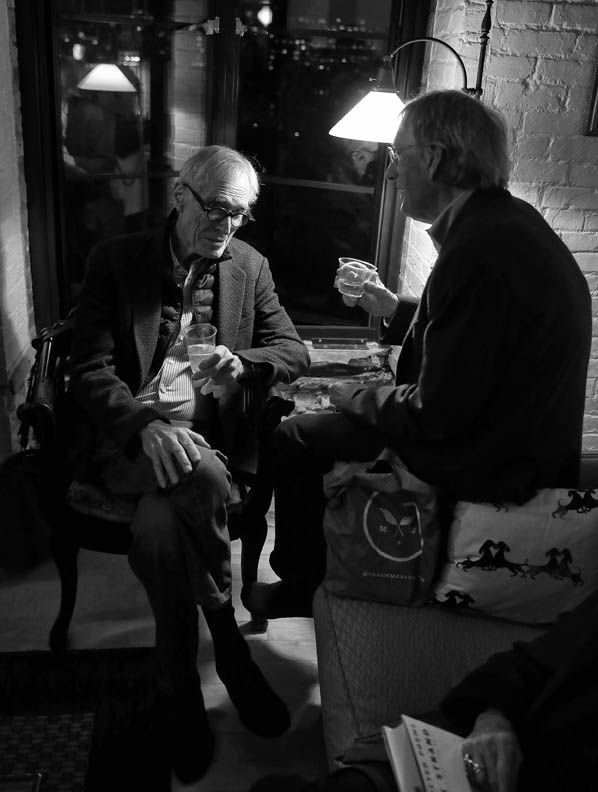 Mark Strand and Charles Wright, talking at Alice Quinn's Home. Copyright Lawrence Schwartzwald.
