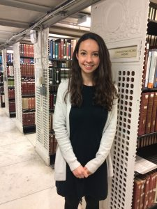 Anastasia near her research shelf in the Library's Main Reading Room.