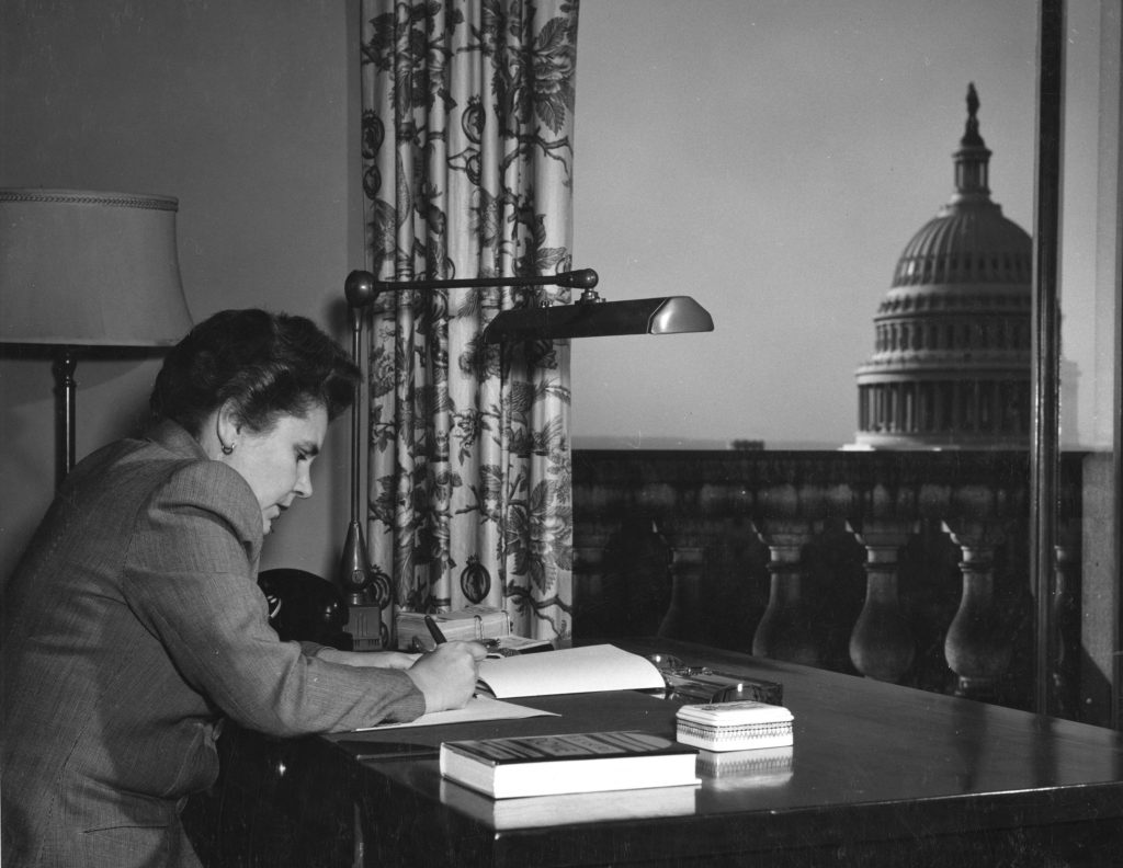 Elizabeth Bishop writing in the Poetry Room at the Library of Congress.
