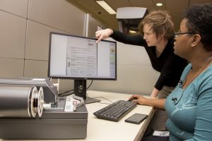 Image of Copyright Office female staff members at work.