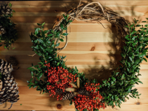 decorated wreath with berries and pinecones