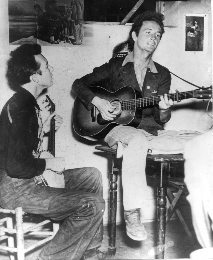 Pete Seeger and Woody Guthrie, circa 1940. Pete plays banjo, Woody guitar.