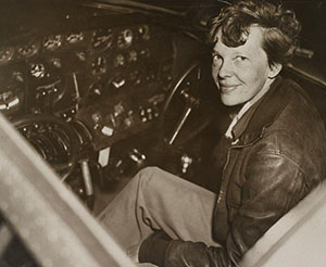 Amelia Earhart in the cockpit of a plane.