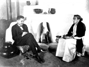 "Juan Rael and Manuela ""Mela"" Martínez seated in front of a fire."