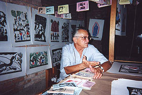 José Francisco Borges, at his poetry stand with his larger format block prints on the wall behind him at the 100 Anos de Cordel event, São Paulo, 2001. Photo by MarkCurran. Not to be duplicated without permission.