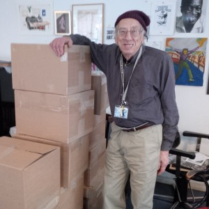 Izzy Young with his collection, boxed and ready to ship.
