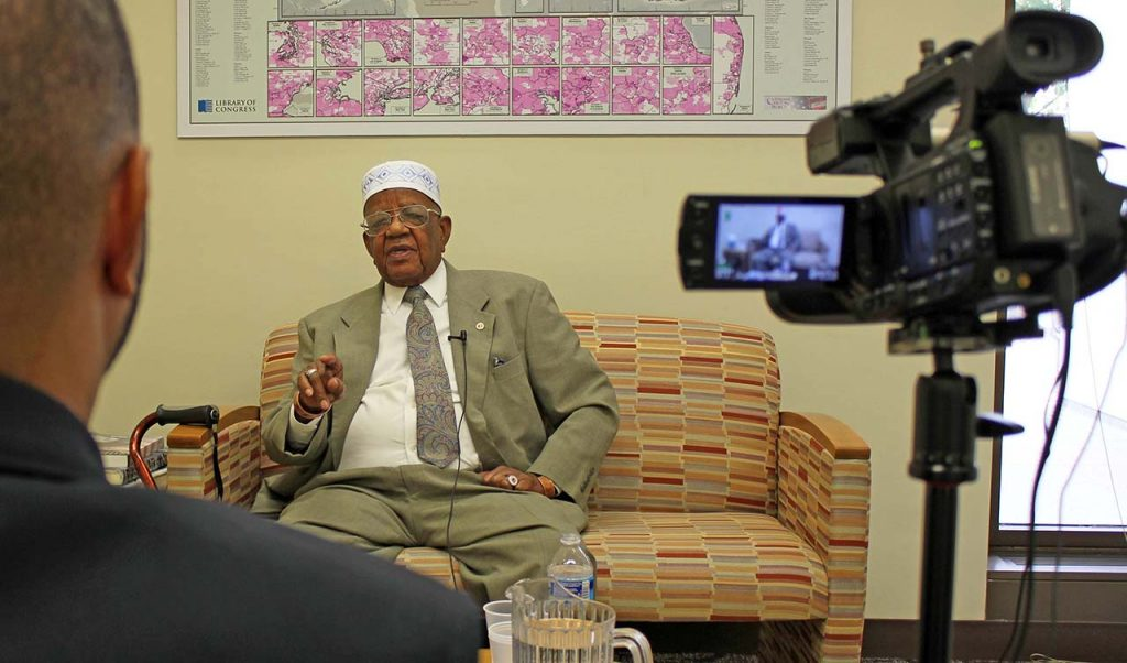 "Lindon Bilal interviews WWII veteran Abdul Kariem in the VHP Welcome Center in the Library's Madison Buildingduring the VHP ""Do Your Part"" Initiative of summer 2015."