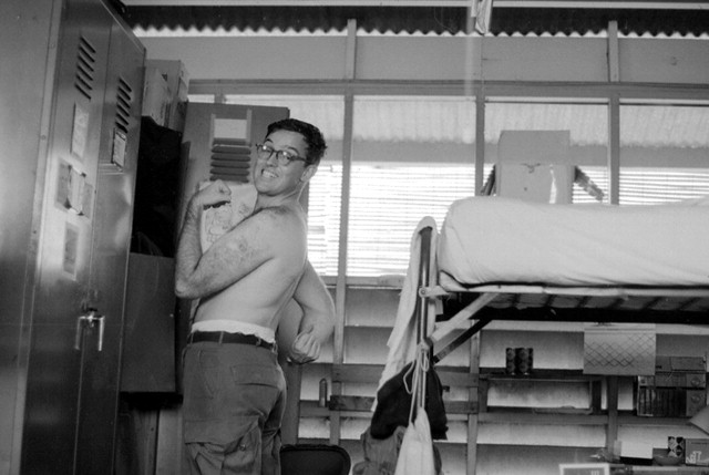 Aldo Panzieri poses by his bunk in Vietnam. Aldo Panzieri Collection, Veterans History Project, AFC2001/001/31863.