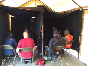 "Recording ""booths"" in the VHP tent. Veteran Oscar Soto on left. Monterey County Stand Down, Seaside, California, 2016."