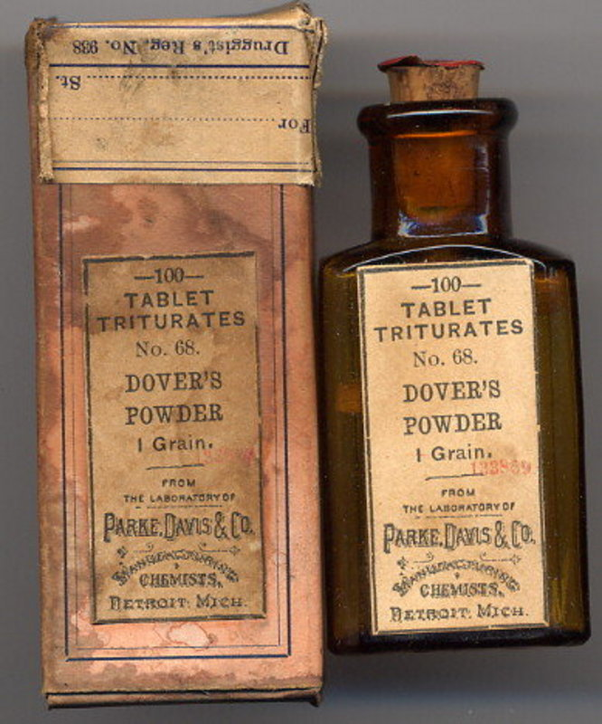 An old bottle of medicine and the box it was sold in.