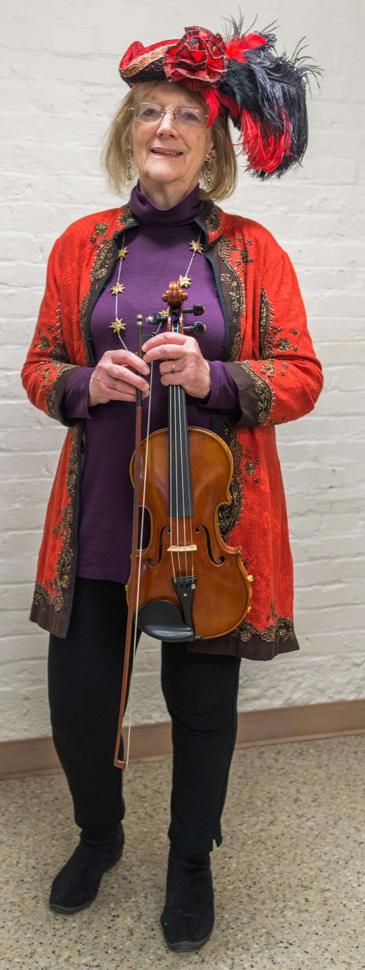 Cast member of the 2016 American Folklife Center Mummers play. Cathy Kerst as Fiddler.
