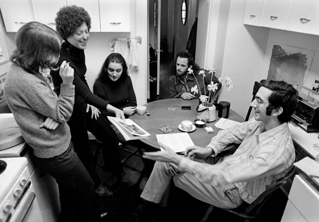 Looking at the layout of the booklet to accompany Rounder LP 0018 _Shaking Down the Acorns_ in the Jabbour kitchen in Washington; DC; April 1973.; Left to right: Elizabeth Weil; the booklet designer; Karen Singer Jabbour; Marian Leighton and Ken Irwin of Rounder Records; and Alan Jabbour.