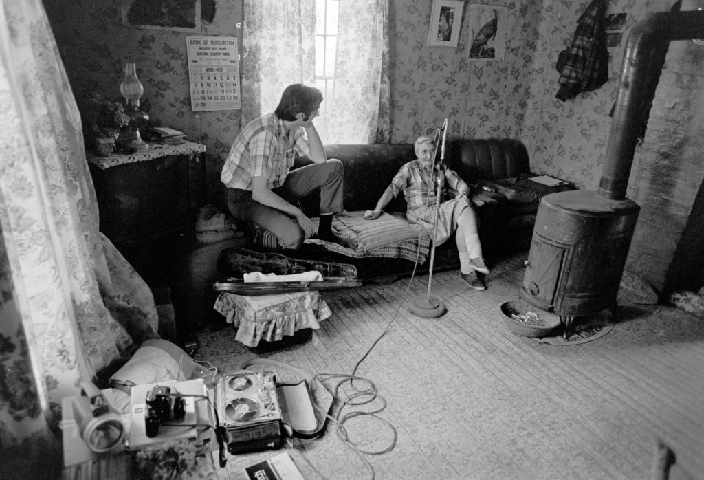 Alan Jabbour recording Maggie Hammons Parker at her home in Stillwell, near Marlinton, West Virginia, April 1973.