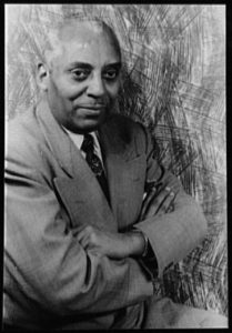 Head and shoulders portrait of an African American man.
