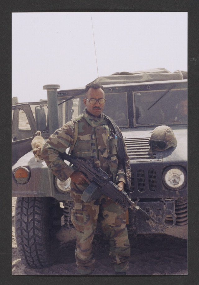Stephen Collins, Jr. in uniform, armed in front of a jeep. Stephen M. Collins, Jr. Collection. Veterans History Project, AFC/2001/001/11615.