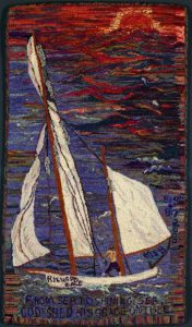 A hooked rug depicting a sailboat on the water.