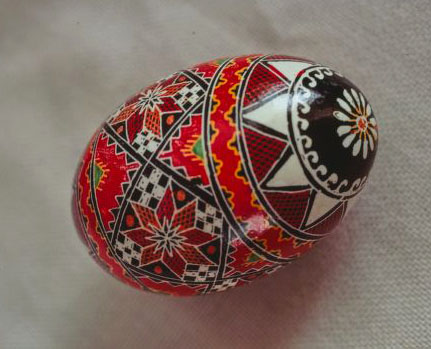 Egg covered in detailed geometric designs,