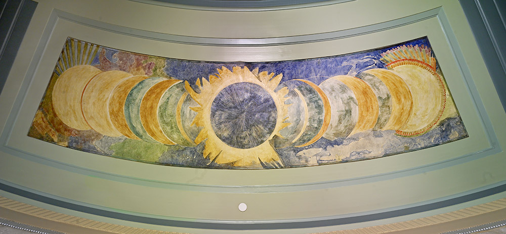 Ceiling mural showing many sequential views of an eclipse with the total eclipse in the center.