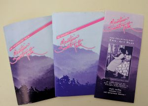 Image of three brochures for the play, Mountain Sweet Talk. The brochures are in the Connie Regan-Blake collection. The photo is by Kaitlin Dotson.
