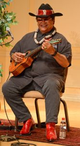 Photograph of Ledward Kaapana playing ukulele during a 2017 appearance in Coolidge Auditorium for a Homegrown concert. Kaapana is a 2011 NEA Heritage Fellow from Hawaii. Photo by Steve Winick.
