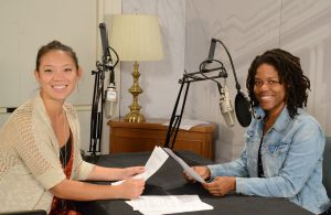 Image of 2018 Bartis Folklife Interns, Mackenzie Kwok and Trelani Duncan. They are seated in front of microphones in the Recording Lab at the Library of Congress.