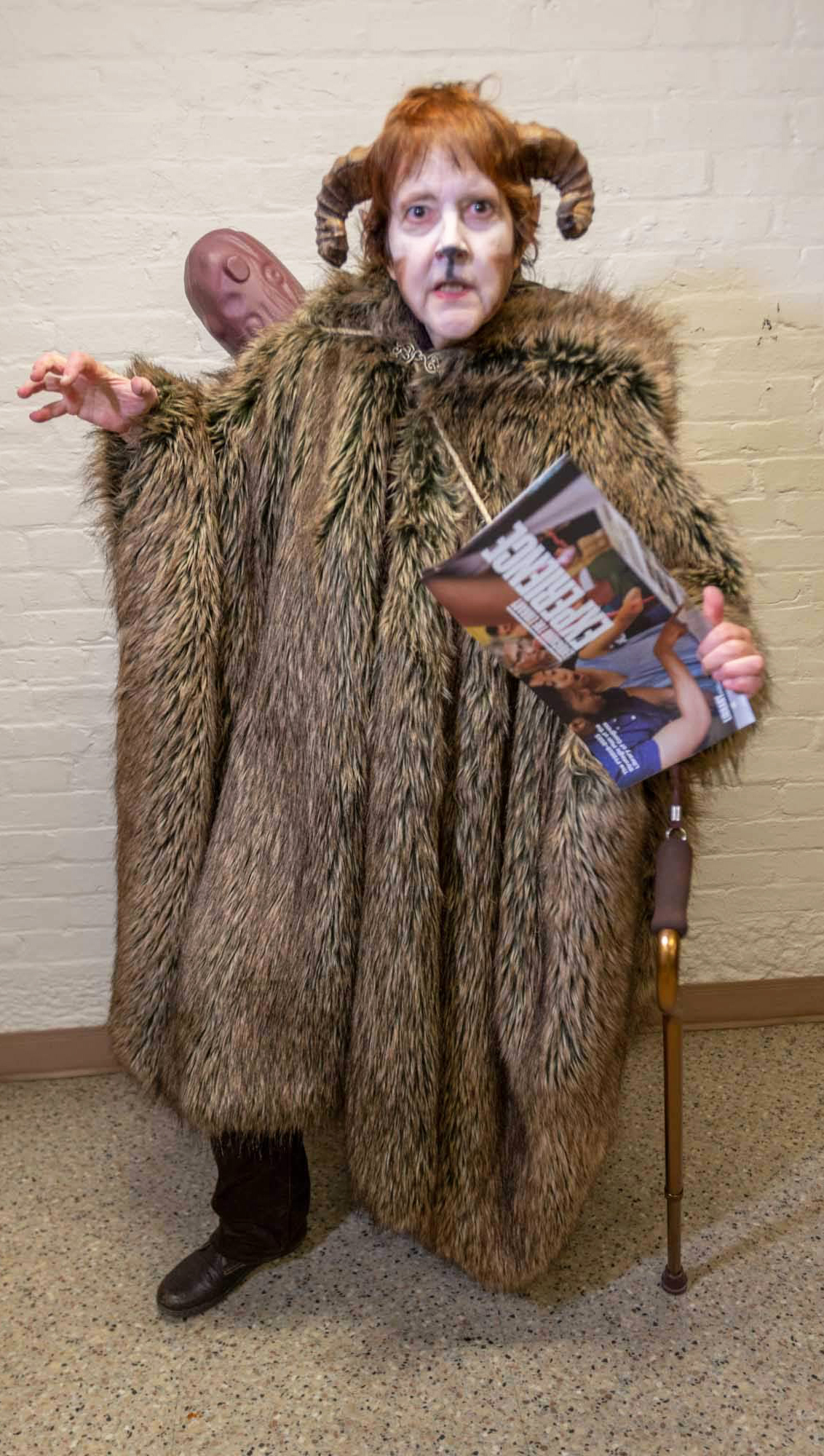 Beelzebub played by Stephanie Hall. The demon is dressed in furs and has ram's horns as well as a club slung across her back.