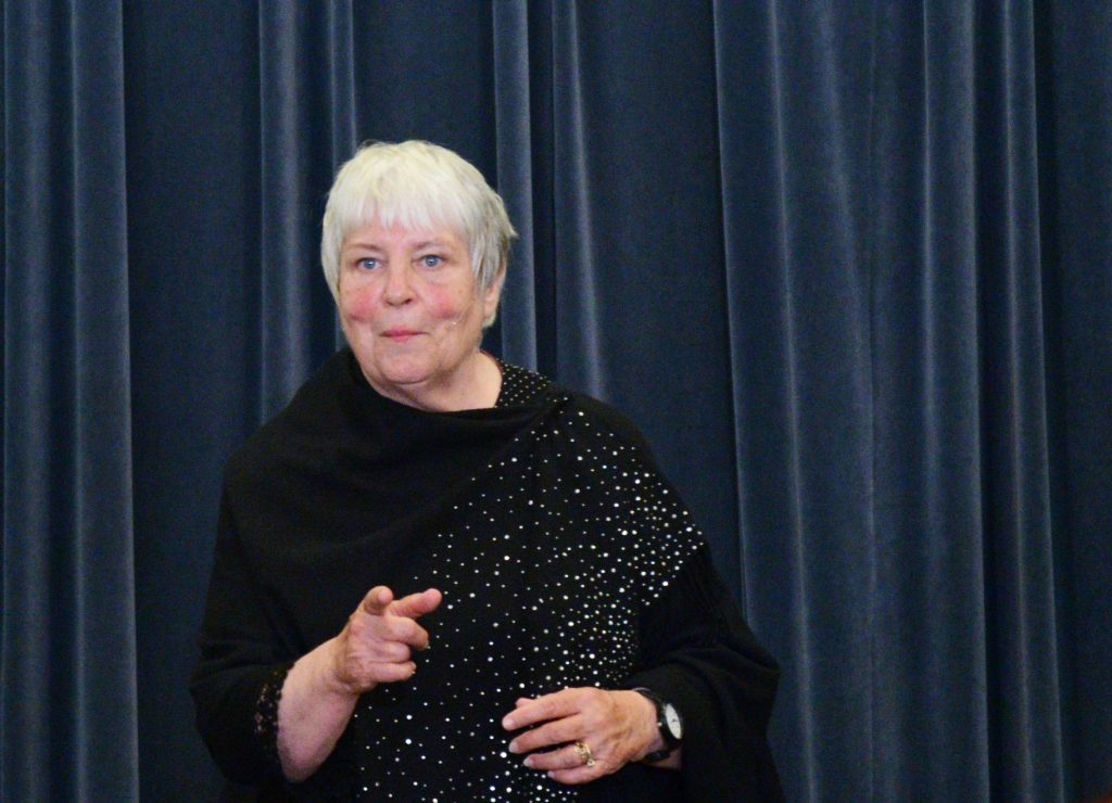 Barbara Freeman points at the audience while telling a story in the Library of Congress's Mumford Room on September 6, 2018.