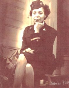 Frances Wills Thorpe seated in uniform.