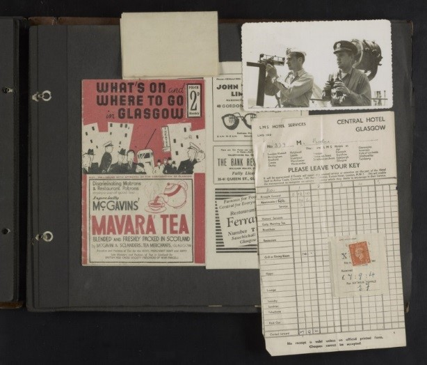 Scrapbook page that includes WWII-era phtographs, pamphlets, and receipts.