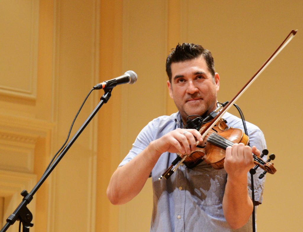 A man playing a fiddle