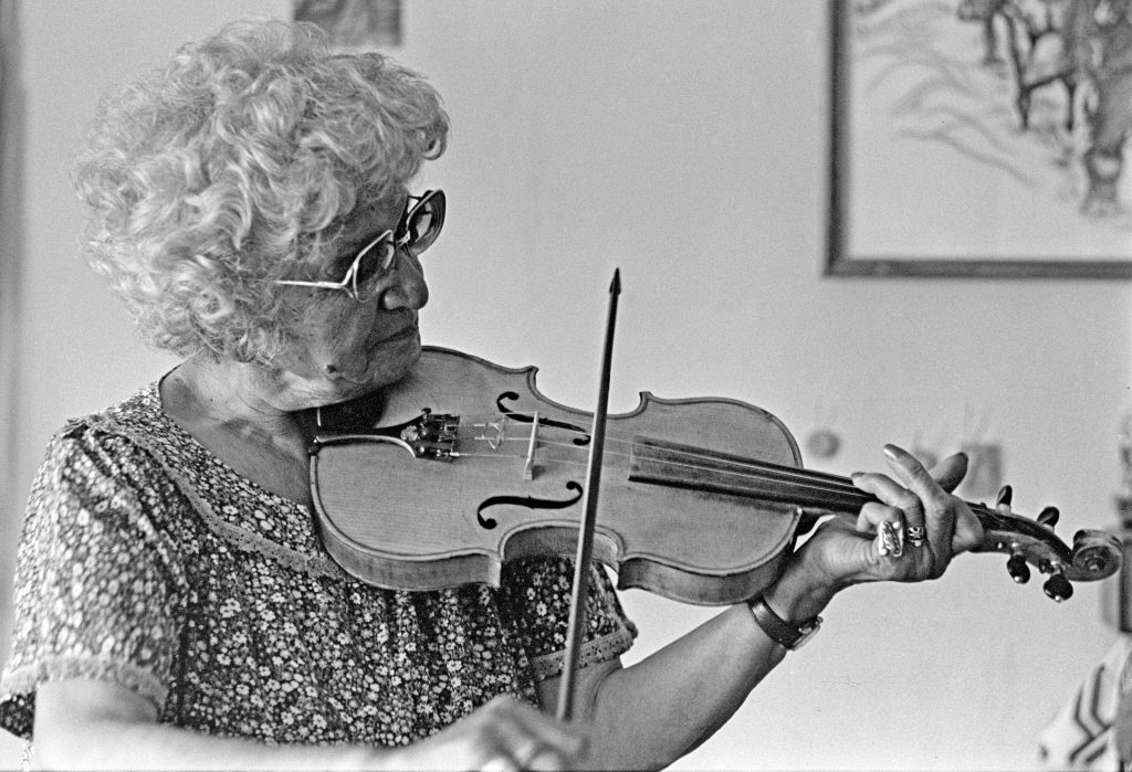 Mary Louise Trotchie plays the fiddle