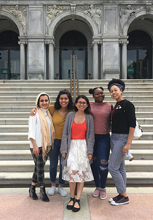 Five young women pose in front of the front steps of the Thomas Jefferson Building, Library of Congress.