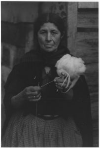 Portrait of a woman holding a ball of wool