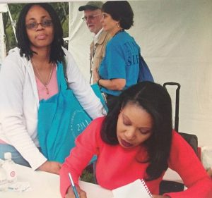Yvonne Brown (left) at the National Book Festival receiving an autograph from Isabel Wilkerson.