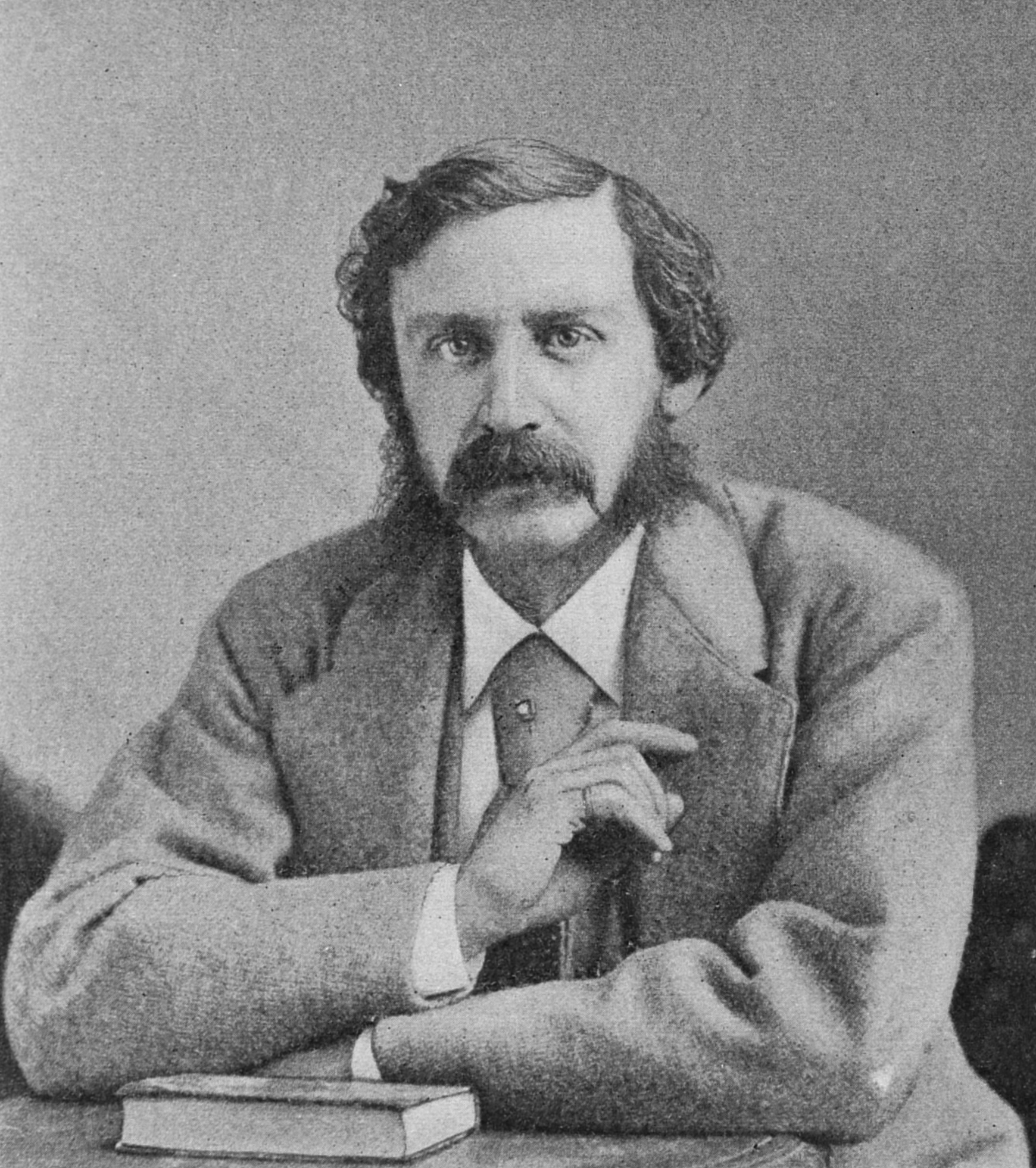 Head and shoulders portrait photograph of Bret Harte.