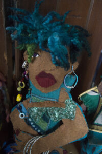 An African American doll made of fabric and beads.