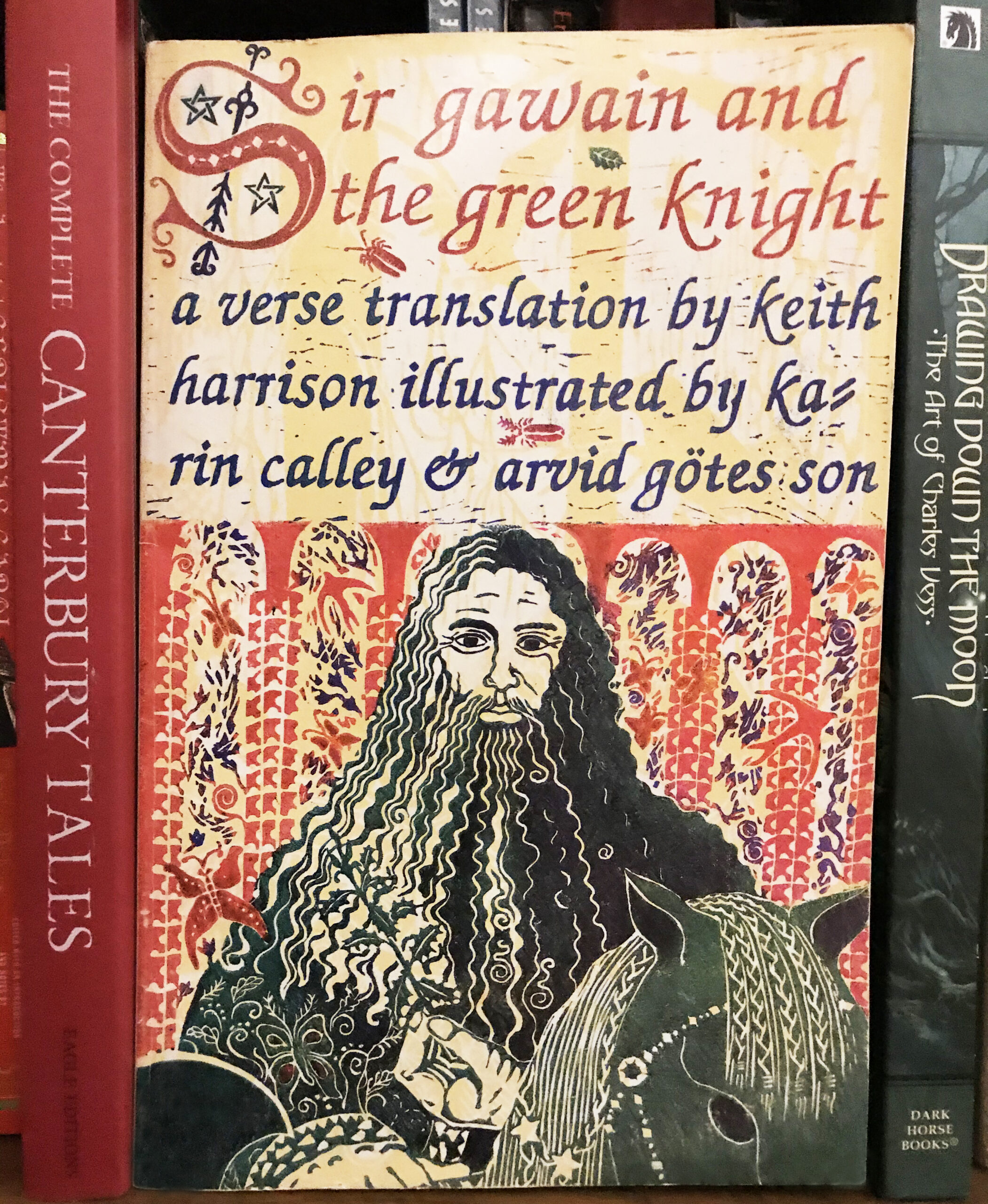 The cover of a book: Sir Gawain and the Green Knight, translated by Keith Harrison. The cover illustration shows a green man with long hair and beard.