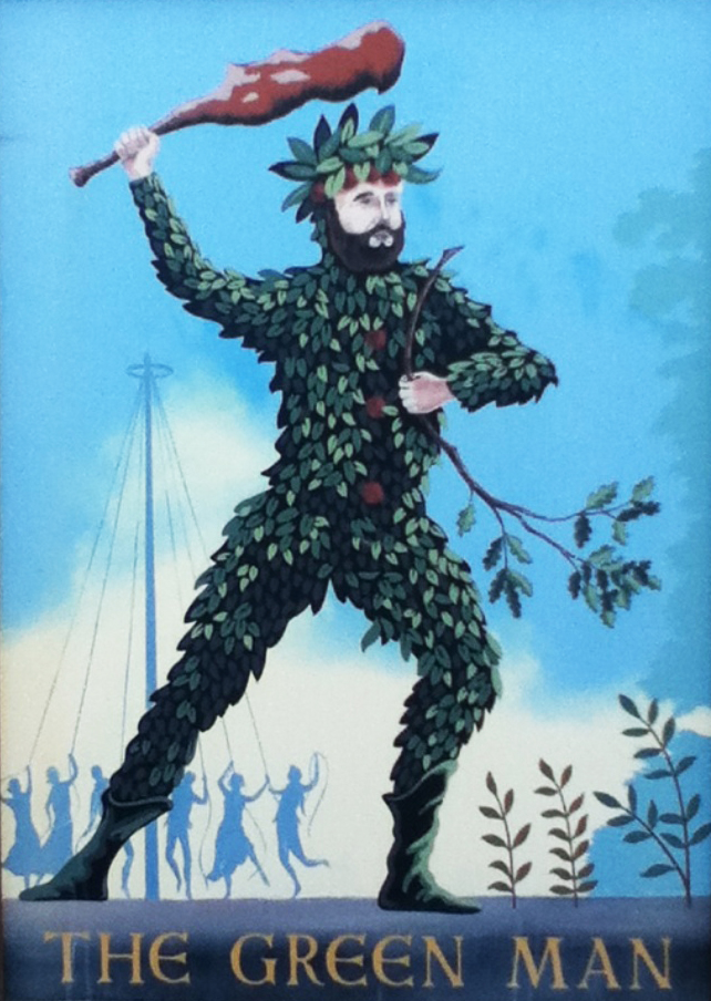 "Pub sign showing a bearded man with a leafy crown on his head and a full suit of leaves. In one hand he catties a club and in the other an oak branch. Behind him, people dance around a maypole. Under him are the words ""THE GREEN MAN."""