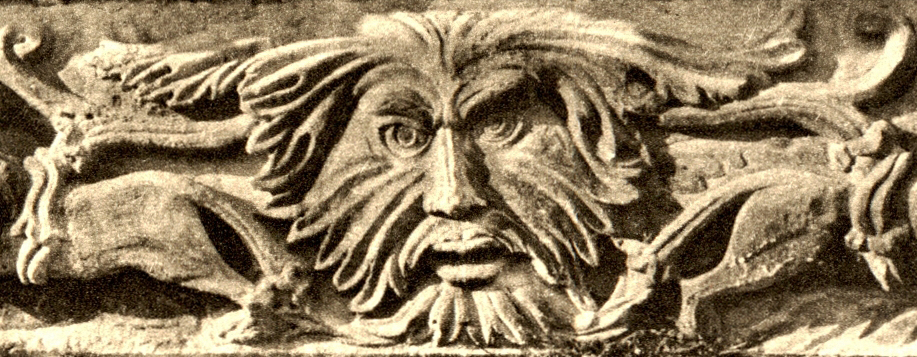 A foliate head carving in which a man's head appears to be formed from leaves.
