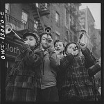 New York, New York. Blowing horns on Bleeker Street on New Year's Day (1943)
