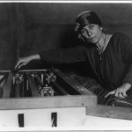 "Mary Hallock Greenewalt, half-length portrait, at electric light ""color organ"", which she invented"