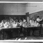 Group of young women performing atmospheric pressure experiments while studying science in normal school, Washington, D.C. (1899?)