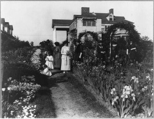 Seven women and two small girls in the garden of Mrs. John W. Paris, Flushing, Long Island, New York