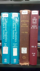 Photo of books on shelf, including Historical Statistics of Black America, United States Negro Population, and U.S. Bureau of the Census: Negroes in U.S.