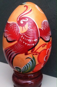 Hand-painted wooden egg with phoenix.  Egg owned and photographed by M. Clifton.