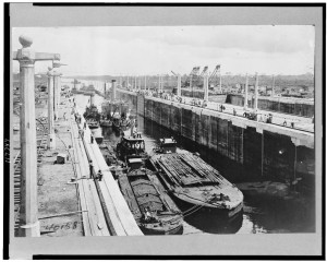 Gatun locks looking toward Atlantic entrance of canal, showing tugs, dredges, and barges ready for first lockage from sea level up into Lake Gatun. c1913. //www.loc.gov/pictures/item/96522036/