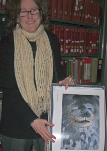"Peg Clifton holding limited edition photography book of ""Antarctica"" by Pat and Rosemarie Keough (2002)"