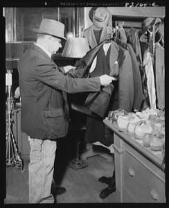 Washington, D.C. Self-help client buying suit in self-help exchange, Jan. 1942. Part of the U.S. Farm Security Administration/Office of War Information Black & White Photographs. //loc.gov/pictures/resource/fsa.8c26375/