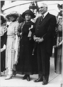 Marie Sklodowska Curie, 1867-1934, holding arm of Pres Harding after she was presented a gram of radium on behalf of the women of America
