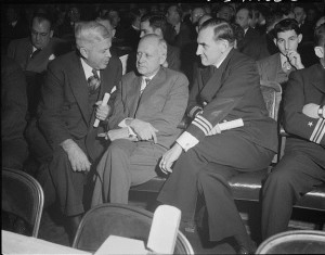 Charles Wilson of the General Motors Corporation with a Navy man and an unknown manufacturer at an early meeting of the Automobile Council for War Production. 1941